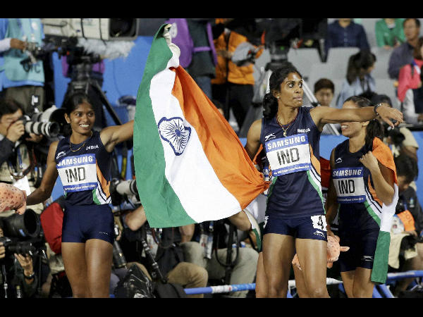Members of India's women's 4 x 400 meters relay team celebrate after winning the gold medal at the 17th Asian Games in Incheon, South Korea on Thursday.