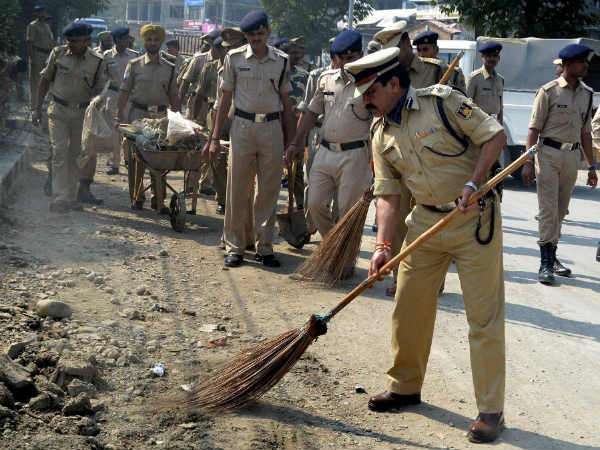 Police Force personnel sweeps the roadsides