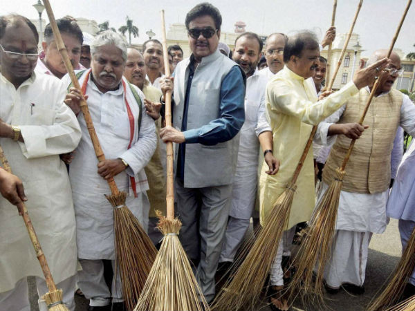 BJP MP Shatrughan Sinha wields a broom with party MLAs