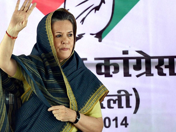 Congress President Sonia Gandhi waves at an election rally