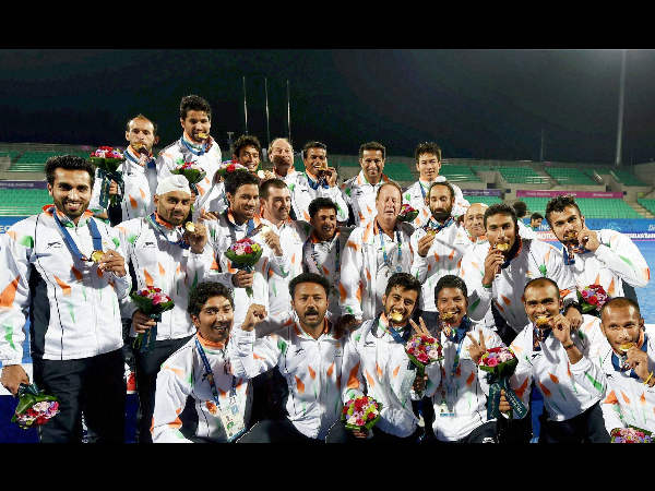 Indian men's hockey players pose with their gold medals