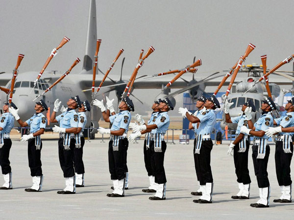 ir Force personnel perform with guns