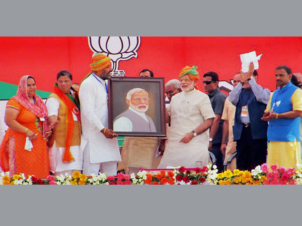 Prime Minister Narendra Modi is presented with his portrait