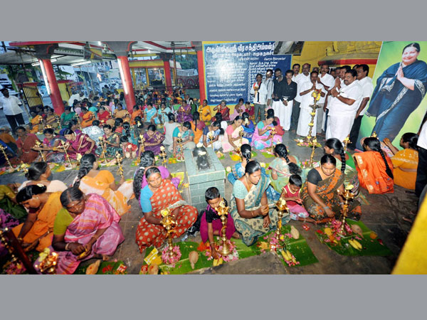 Supporters light lamps at Amman Temple to protest