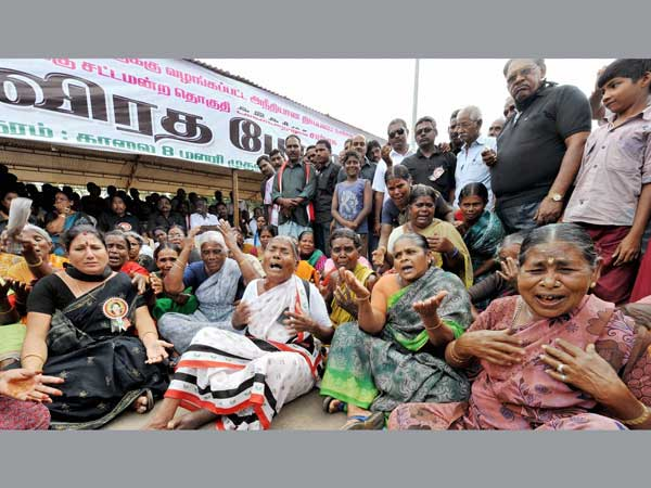 Supporters cry during a protest against AIADMK chief J Jayalalitha's conviction