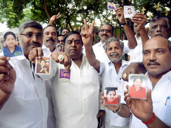 Supporters of jailed AIADMK leader Jayalalithaa showing her photographs