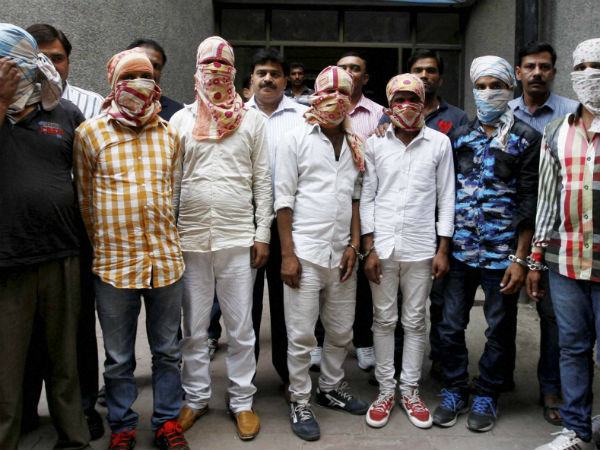 Police with arrested seven men in connection with the allegedly killing three persons in Vijaywada City of Andhra Pradesh last month for Rs one crore, in New Delhi on Tuesday.