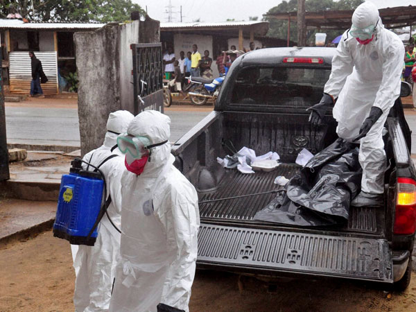 Ebola burial teams go on strike