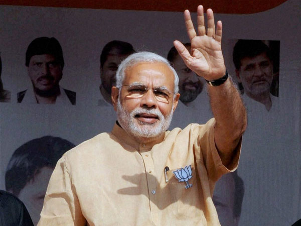 Prime Minister Narendra Modi waves at an election campaign rally