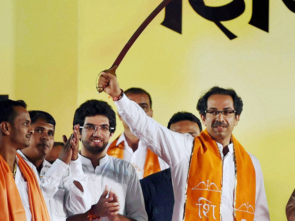 Shiv Sena President Uddhav Thackeray displays a sword
