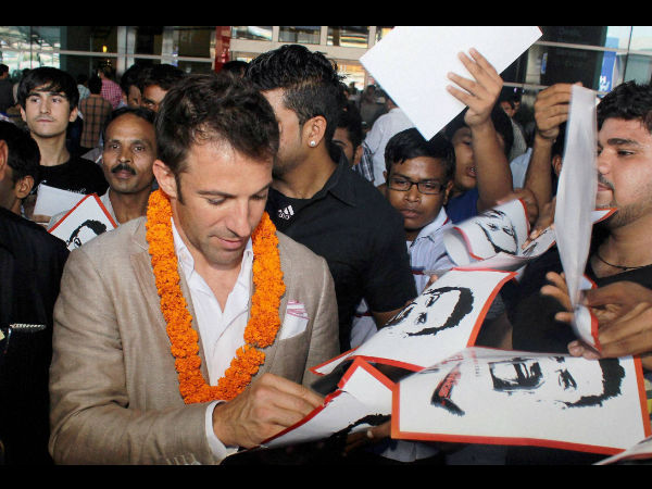 Alessandro del Piero signs autographs for fans at the Indira Gandhi International Airport in New Delhi on September 18 after arriving in India for ISL.