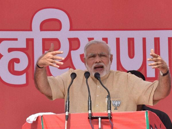 Modi addressing a rally in Haryana