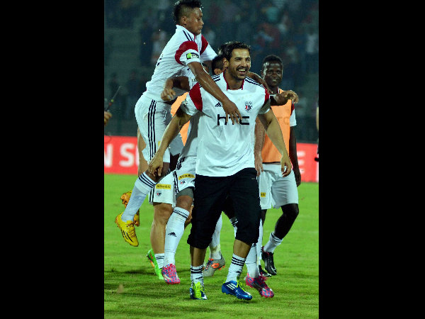 Co-owner of NorthEast United FC John Abraham along with his team celebrates after the victory against Kerela Blasters by 1-0 in Guwahati on Monday.