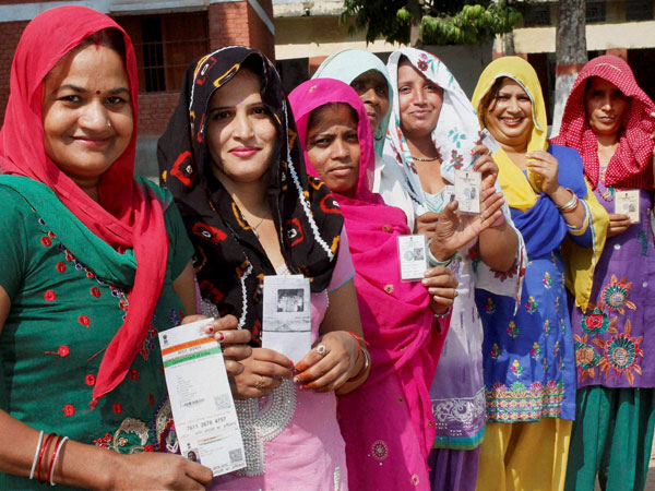 Voters showing their voter identity cards