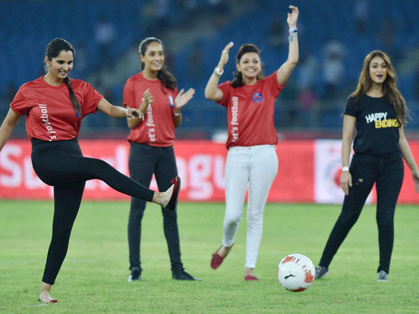 Tennis Star Sania Mirza kicks a football during the ISL 2014 match