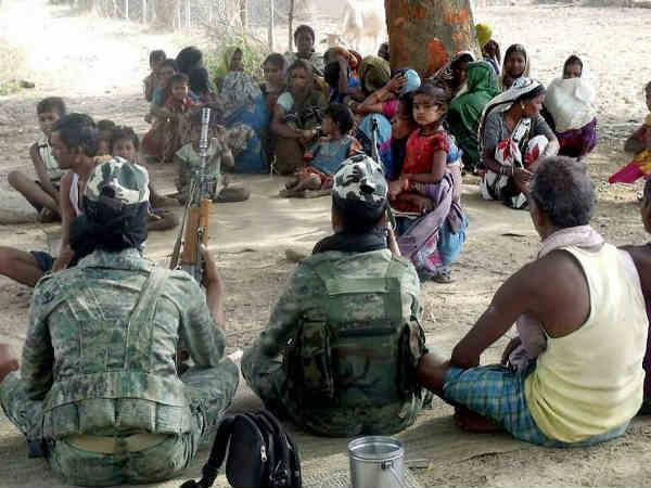 Naxals open fire on poll center