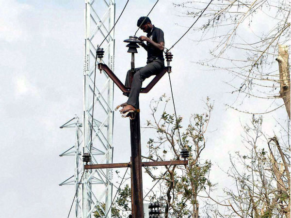 Vizag: Relief and Rehabilitation work in full swing after the devastating Hudhud Cyclone hit Vizag on Wednesday. PTI Photo