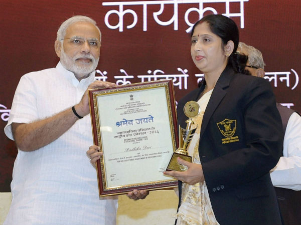 Prime Minister Narendra Modi felicitates Radhika Davi, one of the National Brand Ambassadors for vocational training, at the launch of Pandit Deendayal Upadhyay Shramev Jayate scheme in New Delhi.