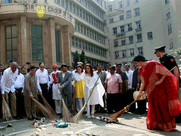 Sweeping dirt off Mumbai