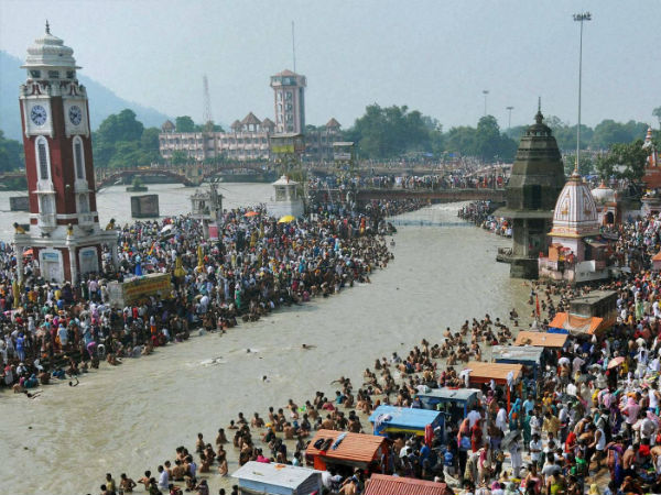 Devotees taking bath in Ganga in Haridwar.