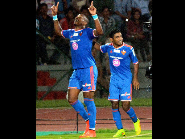 Gregory Arnolin of FC Goa along with his team-mate celebrates the first goal against North East United FC at Indira Gandhi Stadium in Guwahati on Sunday.