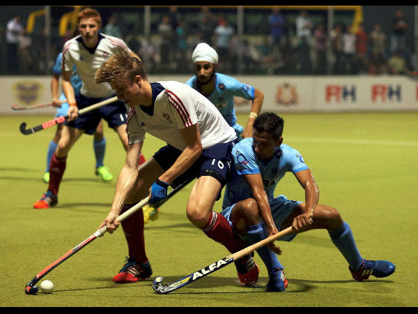 Indian hockey players vie for the ball against Great Britain in the final of the Sultan of Johor Cup 2014 in Johor Bahru on Sunday.