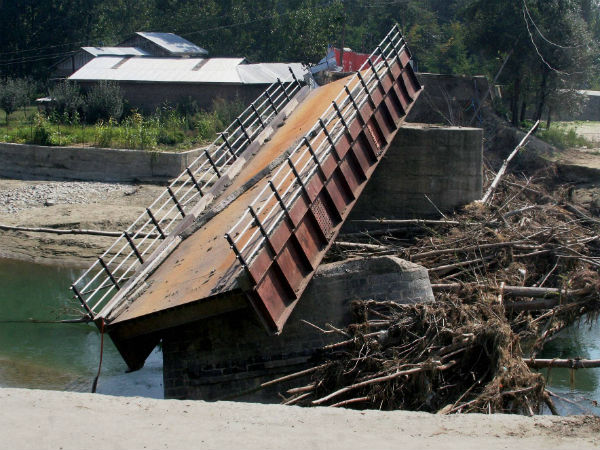 A bridge that connects Pulwama to Srinagar lays destroyed due to the Jammu and Kashmir flood devastation in Pulwama on Sunday.
