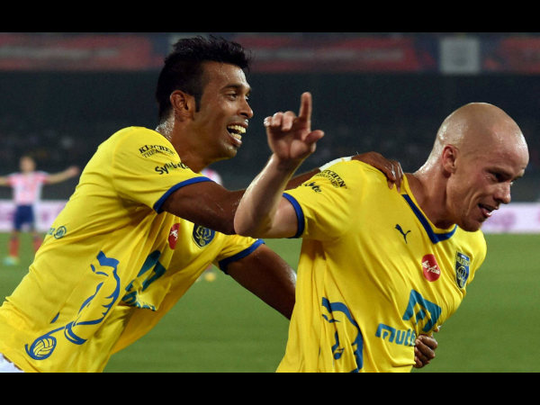 Kerala Blasters FC's Iaine Hume (right) celebrates after scoring a goal against Atletico de Kolkata during ISL in Kolkata on Sunday.