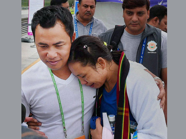 File photo: Sarita Devi with her husband at the Asian Games