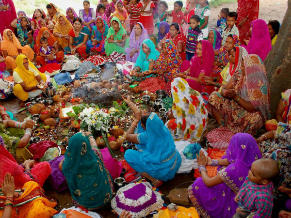 Women performing rituals on the Lalhi Chhath festival in Mirzapur. (PTI Photo)