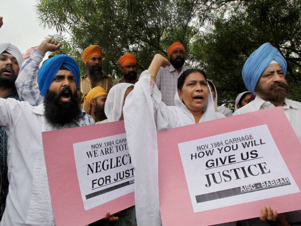Victims of 1984 anti-Sikh riots shout slogans during a protest demanding justice. (PTI Photo)