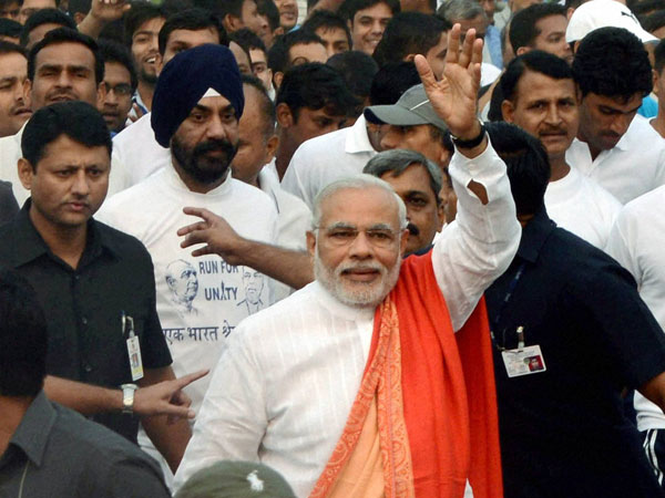 rime Minister Narendra Modi waves during the 'Run for Unity'