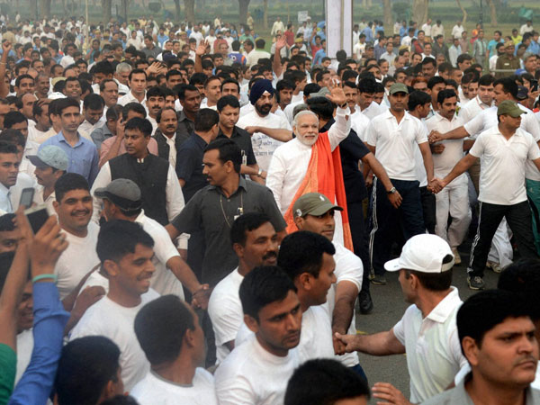 Prime Minister Narendra Modi waves during the 'Run for Unity'