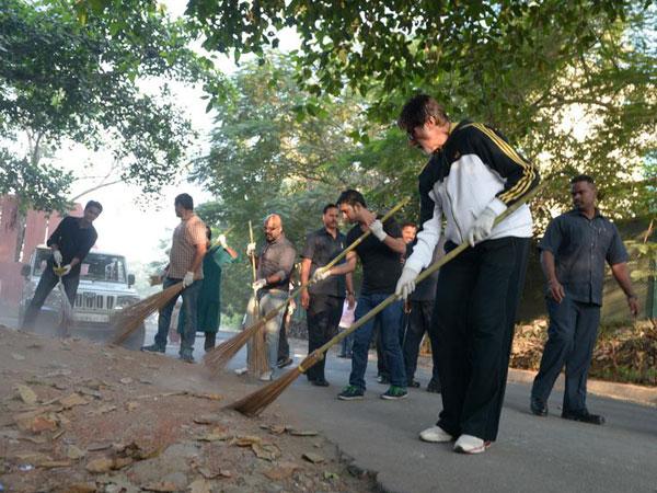 Big B seen wielding the broom