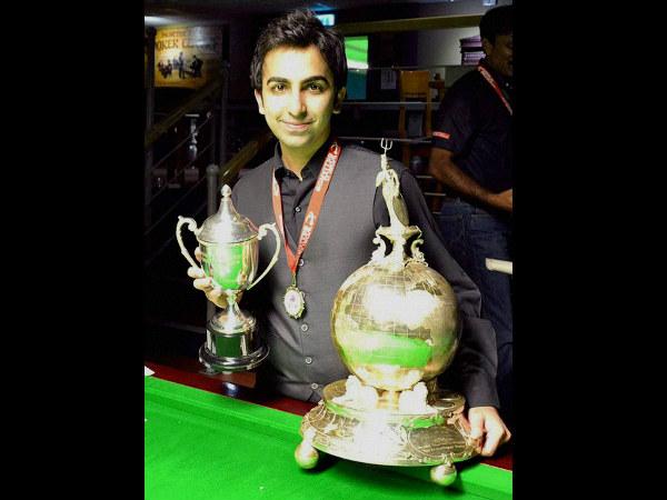 Pankaj Advani poses with his two World Billiards titles