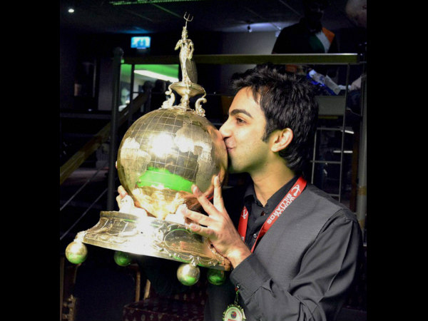 Pankaj Advani kisses his trophy after winning the World Billiards Championship (time format) in Leeds on Wednesday.