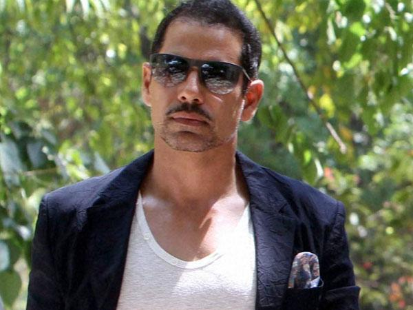 Robert Vadra landed in a fresh controversy as he was caught on camera for losing his cool and pushing away a journalist who asked him questions regarding land deal in Haryana.
