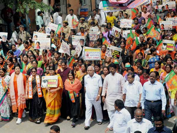 BJP Leader B S Yeduyurappa, R Ashok and MP Shobha Karandlaje along with Mahila Morcha activists protest against the recent sexual harresment cases on children in Bengaluru on Wednesday.