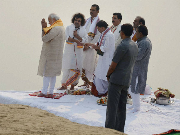 Prime Minister Narendra Modi offers prayers with priests during at the Assi Ghat in Varanasi on Saturday.