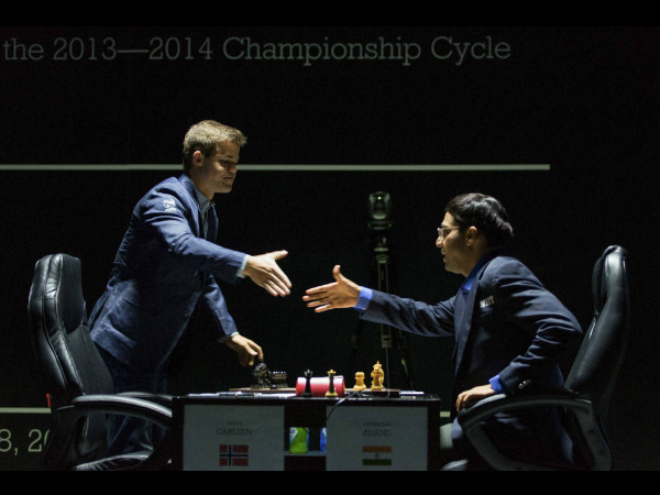 Norway's Magnus Carlsen (left), currently the top ranked chess player in the world, and India's former World Champion Viswanathan Anand, right, shake hands before the FIDE World Chess Championship Match in Sochi, Russia, Saturday.