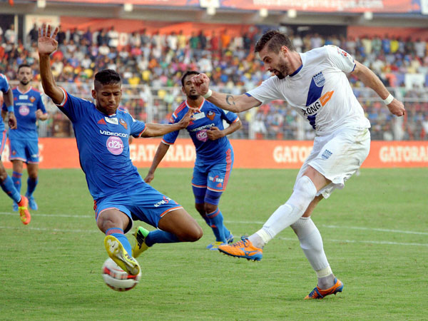 Mumbai City FC and FC Goa players in action during the ISL match in Fatorda, Goa on Sunday.