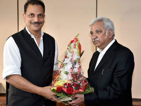 Rajiv Pratap Rudy being welcomed by Sunil Arora