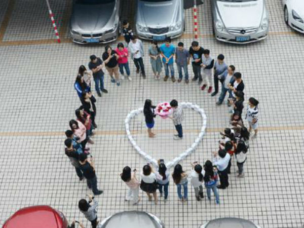 Chinese man proposes with a ring of 99 iPhones, she says no.
