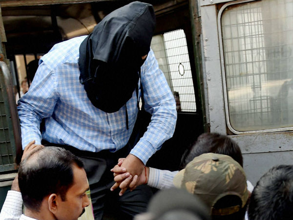 NIA officials produce ZIa-ul-Haque, arrested in connection with Burdwan blast at a local court in Kolkata on Saturday.