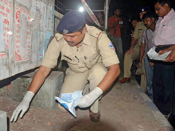 Police officials investigates at the blast side after a powerful explosion outside the Central Reserve Police Force (CRPF) camp, where the National Investigation Agency (NIA) officials probing Bardhaman blast case main accused Sajid Khan is under NIA custody at Salt lake area under North 24 pargana district near Kolkata