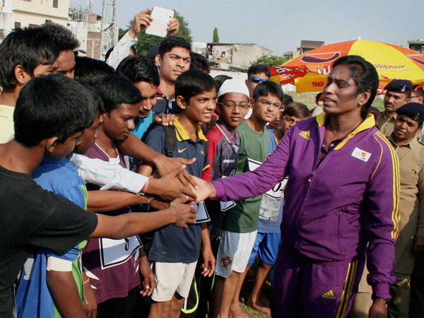 Former sprinter P T Usha (R) interacting with children