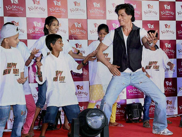 Bollywood actor Shahrukh Khan dances with kids