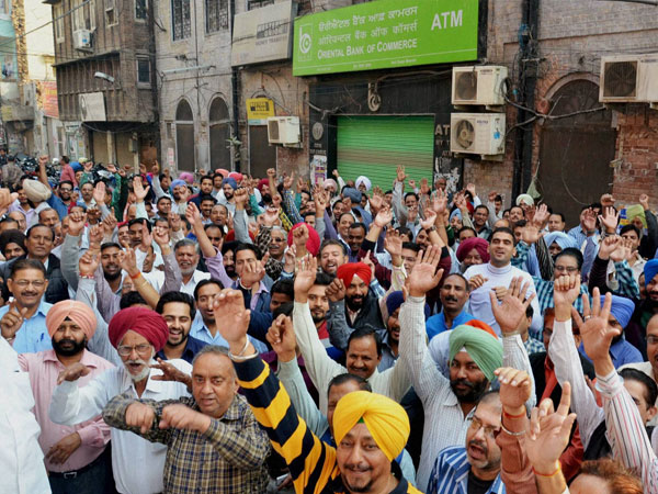 Bank employees demonstrate in front of Bank of India during their one-day nationwide strike in Amritsar on Wednesday.