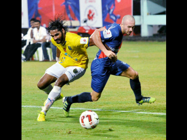 Kerala Blasters FC (Yellow) and Mumbai City FC (Blue) players in action during the ISL match in Kochi on Wednesday.