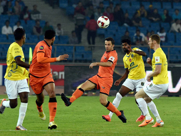 Delhi's Alessandro del Piero (centre) kicks the ball as other players watch